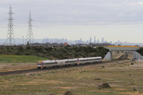 Ballarat bound VLocity train approaches a red signal at the end of the double track at Caroline Springs