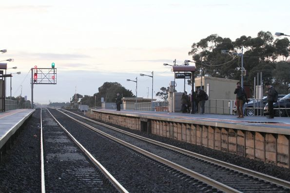 Handful of commuters wait for their citybound train at Rockbank station