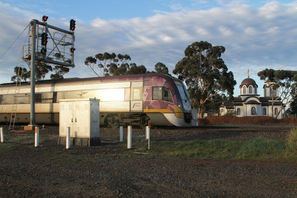 VLocity VL15 arrives into the loop road at Rockbank, ready to cross an up train