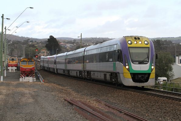 VLocity VL32 and classmate depart Bacchus Marsh with an up Ballarat service, with A66 and N460 stabled in the yard