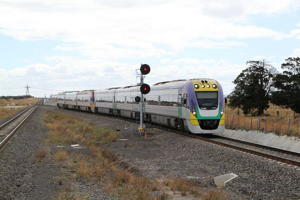 VLocity VL37 leads VL14 into Caroline Springs station on the up