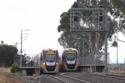 VLocity VL04 and VL61 on opposing trains cross at Melton station