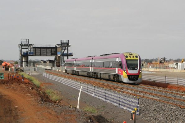 Tuesday, 23 April - VLocity VL47 passes through the new station at Cobblebank on the down