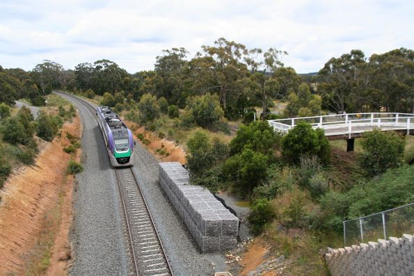 VLocity VL14 passes the old bridge at Portland Flat Road, about the pass under the new one