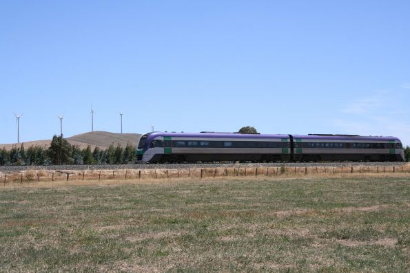 VLocity VL27 bound for Ararat, the Challicum Hills wind farm in the background
