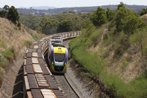 VLocity VL07 climbs up Warrenheip Bank on an up service, passing a down grain from Geelong