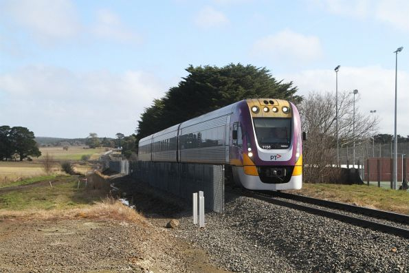 VLocity VL58 on a citybound service passes track duplication works at Ballan