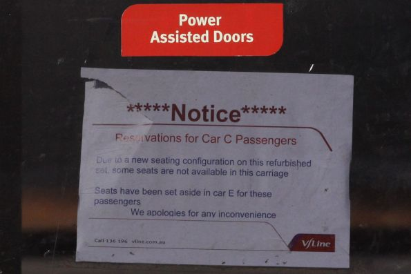 Seat reservation notice on the door of the BDN carriage of set SN16