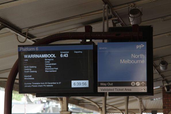 Last day of Geelong line trains stopping at North Melbourne, with a Warrnambool train next to depart