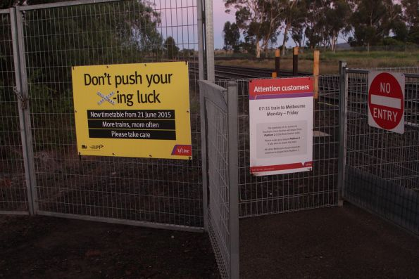 V/Line 'Don't push your x-ing luck' poster at Little River station