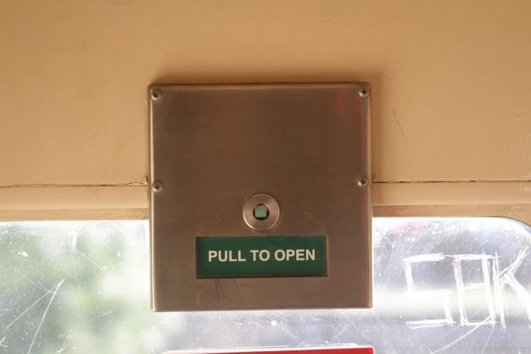'Pull to open' sign on the door of a power door fitted N set