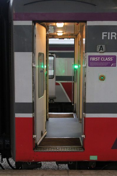 Open doors on both sides of an N set carriage at Southern Cross Station