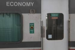 'When light is green / Push door to open' stickers on an N set carriage
