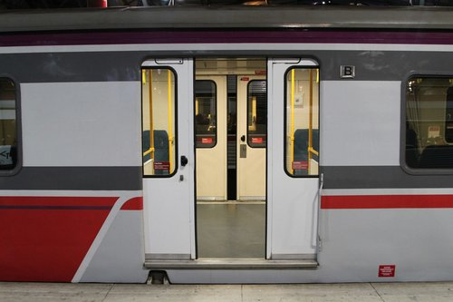 Empty carriage set at Southern Cross, doors on both sides of the train open