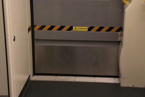 'No crew steps' notice on the wheelchair access door of VLocity 13xx cars in sets VL60 and above