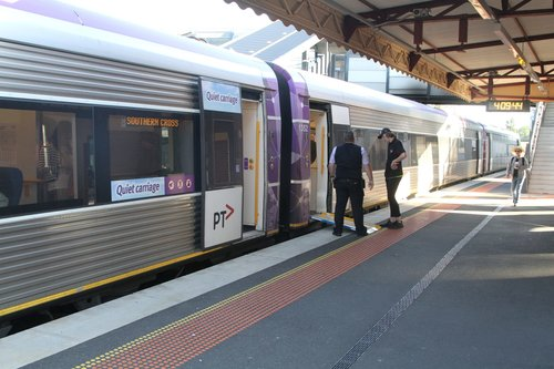 VLocity train conductor deploys the wheelchair ramp at Footscray station