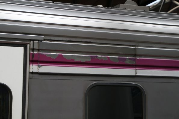 Patched section of stainless steel fluting on the side of Sprinter 7021