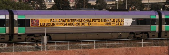 Advertisement for the Ballarat International Foto Biennale on VLocity carriage 1326