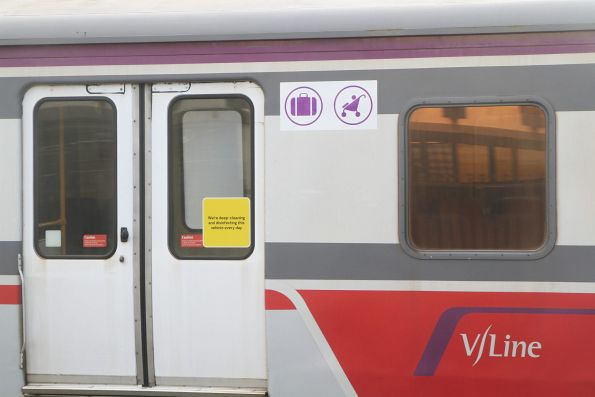 'Luggage and prams' signage beside a H set carriage door