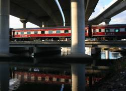 Carriage set SN7 passes under the CityLink viaduct at Moonee Ponds Creek, with open doors bound for Geelong