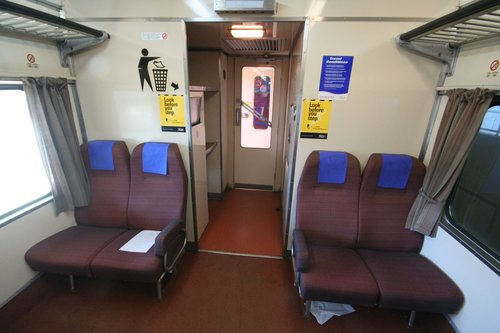 BTN263 looking to the west end toilet and luggage racks