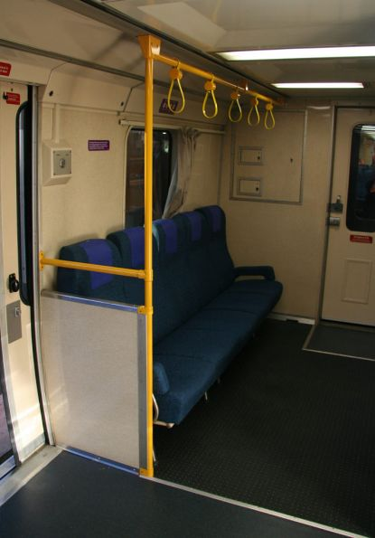 Extra longitudinal seats and grab rails at the toilet end