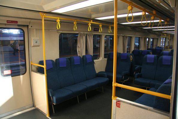 Extra longitudinal seats and grab rails in a 3-car SH set used on the push-pull Sunbury / Bacchus Marsh runs