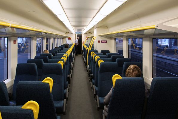New style interior onboard VLocity VL00: yellow poles and the same fabric as all of the other refurbished V/Line trains