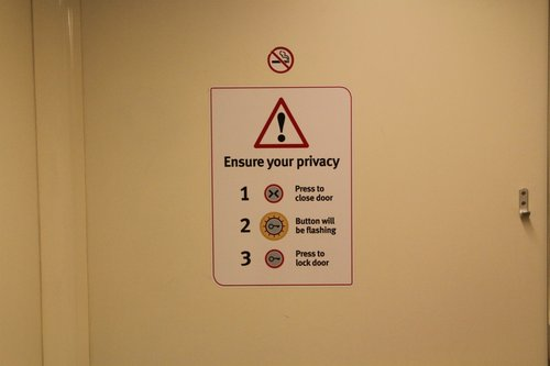'Ensure your privacy' signage inside the disabled toilet onboard a VLocity train