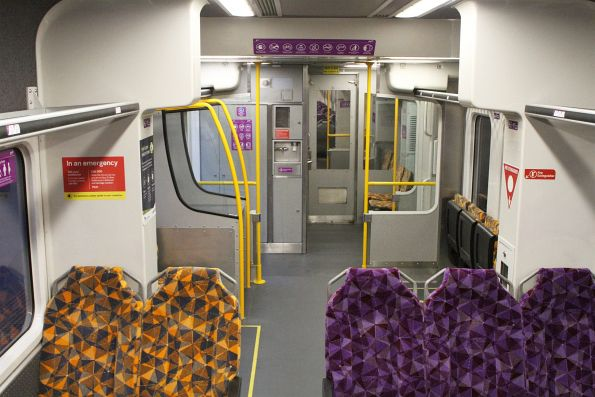 Purple and orange PTV seating onboard the wheelchair area of refurbished Sprinter 7021