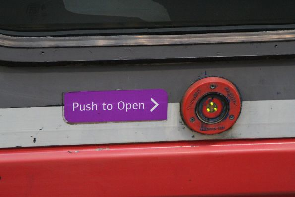 'Push to open' button beside the exterior door of Sprinter 7009