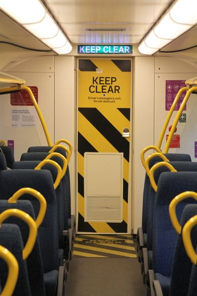 Bolder 'KEEP CLEAR' signage on the cab door of VLocity carriage 1269