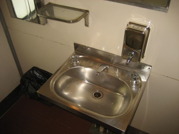 BS216: stainless steel washbasin, and a glass shelf still unvandalised