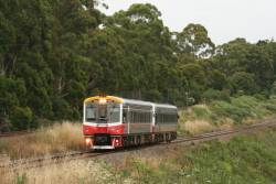 Sprinter 7003 and classmate depart Drouin on the down