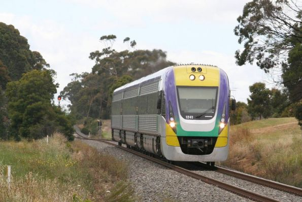 Three car VL41 departs Traralgon on the up