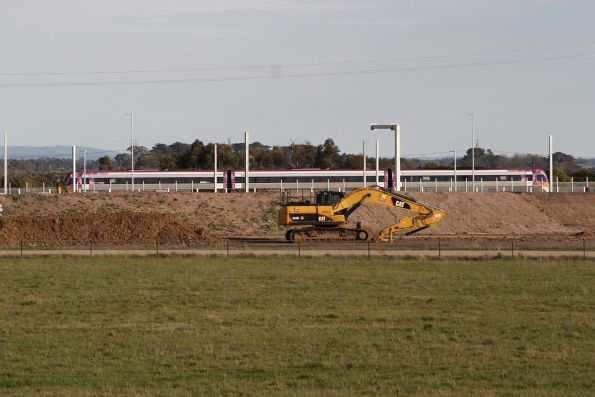 VLocity VL58 bound for Melbourne passes construction work at the new Pakenham East train depot