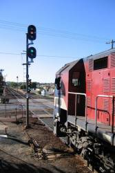 With the signal at proceed, N473 departs South Geelong for Melbourne