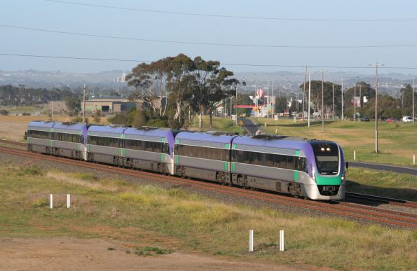 VL01 leads two classmates on an up Geelong express service at Corio