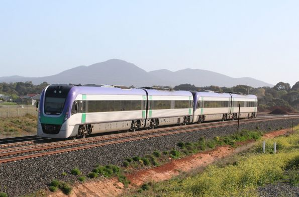 VL20 and VL30 on the banked curve at Lara, You Yangs in the background