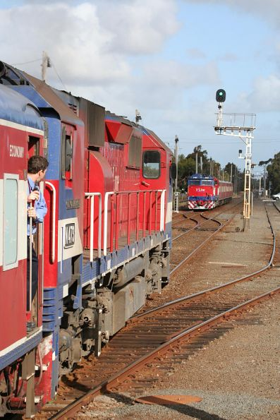N473 heads to Marshall while N463 waits in the siding at South Geelong