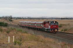 N454 on an up Geelong service outside Little River