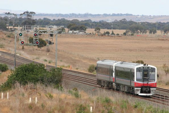 7016 and 70xx on a down Geelong service outside Little River
