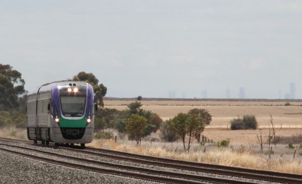 VL33 arrives at Little River, with the Melbourne skyline showing through the haze
