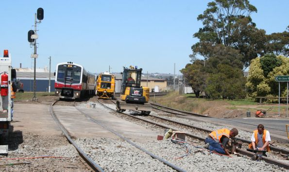 Sprinter 7008 and two classmates lead an up service through an active worksite at North Shore