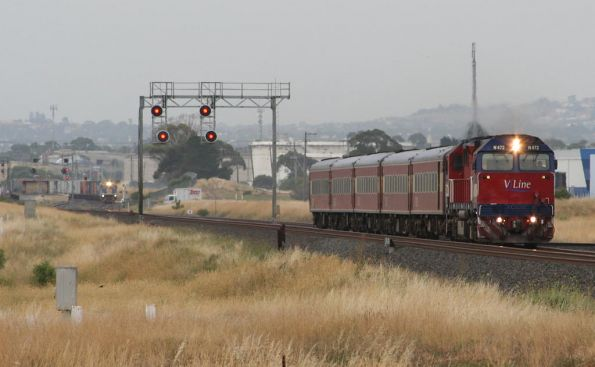 N472 on the up with a SG freight coming up behind at Corio
