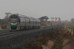VLocity on the up in the rain near Lara