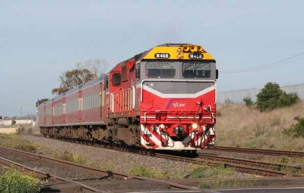 The other repainted N class, N468 on the up at Corio