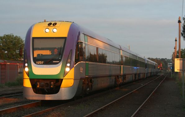 3VL37 leads the first 7 car train, empty cars at South Geelong