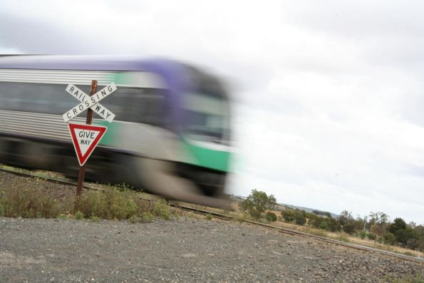 VLocity train passes through an unprotected level crossing