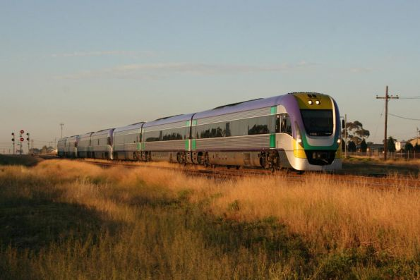 7 car Vlocity on an Melbourne bound express runs through North Shore